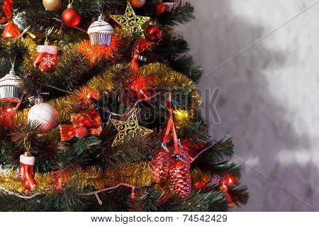 Red and gold Christmas decoration on the fir tree