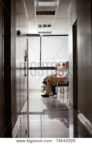 Group of people sitting together in hospital's waiting area