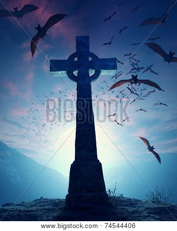 Celtic Cross with swarm of bats invading against misty moon