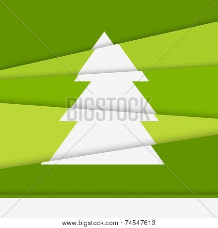 Creative Christmas tree card. Asymmetric Christmas tree formed from paper