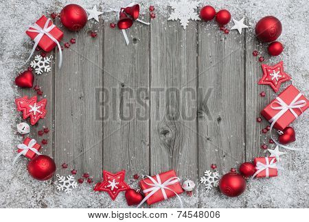 Christmas background with festive decoration over wooden board