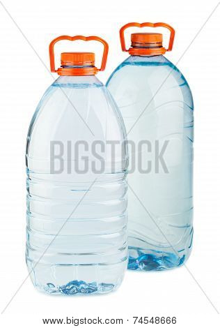 Two Big Plastic Water Bottles With Orange Caps