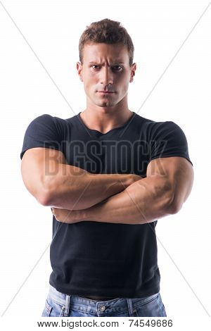 Muscled Man Crossing Arms With Serious Face