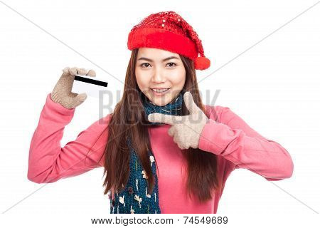 Asian Girl With Red Christmas Hat Smile Point To  Credit Card