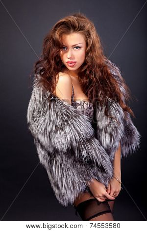 Attractive Woman In Fur Coat And Bra