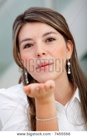 Woman Blowing Kisses