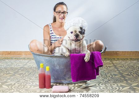 Woman Bathing A Dog