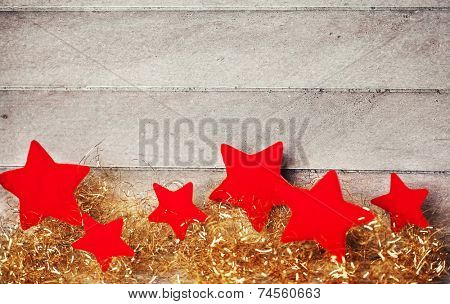 Red stars on wooden background