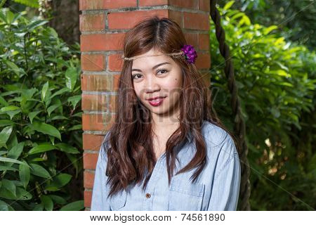 Filipina Woman In A Garden