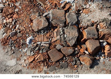 Pieces Of Beaten Bricks On The Ground
