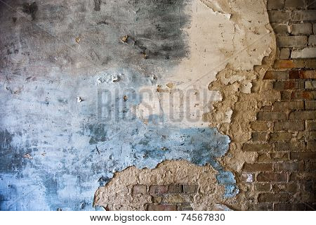 Damaged Plaster On The Brick Wall