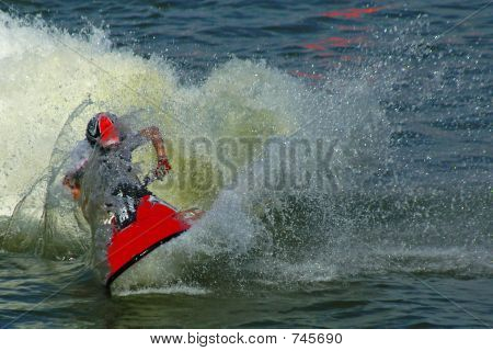 someone riding a jetski surrounded with water drops