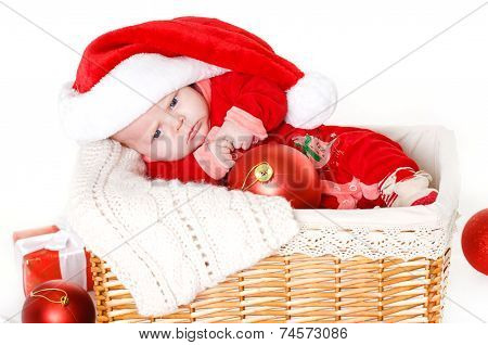 Little Santa Claus is in the basket.
