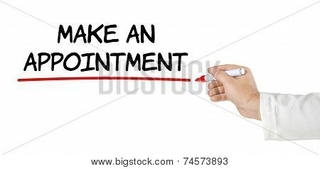Hand with pen writing Make an appointment