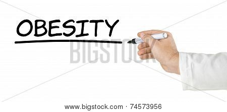 Hand with pen writing the word Obesity