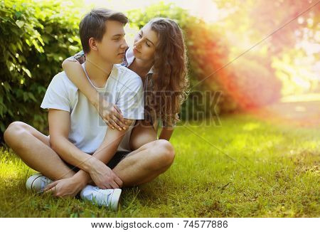 Lovely Young Teen Couple In Love Having Fun On Lawn In Park, In Summer Sunny Day