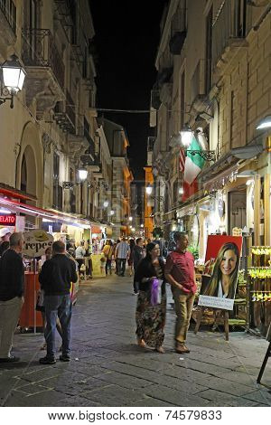 Tourists On Via San Cesareo In Sorrento, Italy At Night