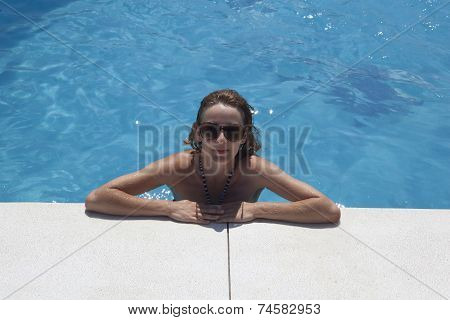 Woman With Sunglasses Bathes In Pool