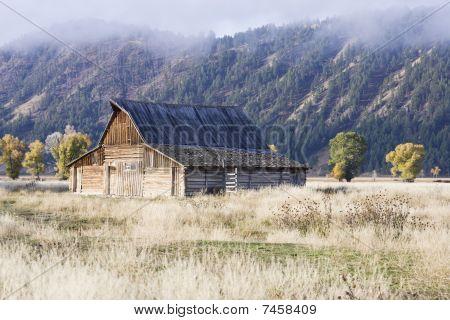 Remote Barn In An Open Field