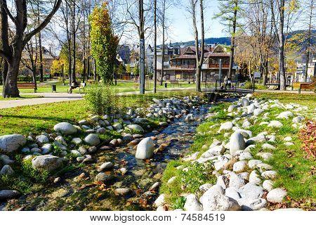 Foluszowy Stream Flows Through The City Park