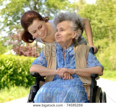 Senior  woman in a wheelchair with her granddaughter