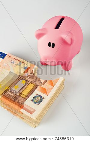 Piggy Coin Bank Eating Fifity Euro Pile