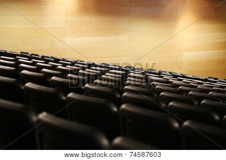 Bank Of Empty Seats In An Auditorium