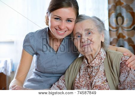 Senior woman with her home caregiver