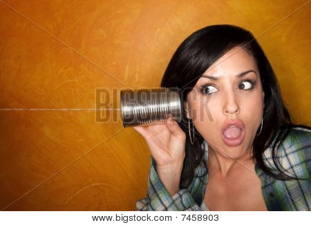 Hispanic Woman With Tin Can Telephone