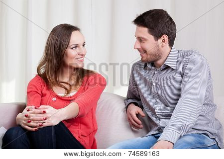 Loving Couple Sitting On Couch