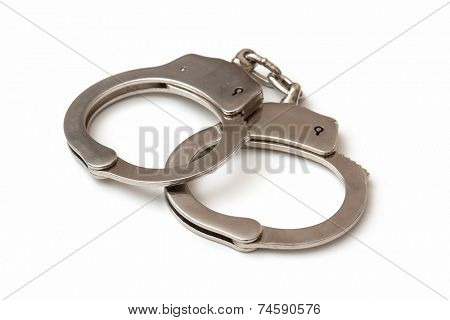 Pair of handcuffs on a white background