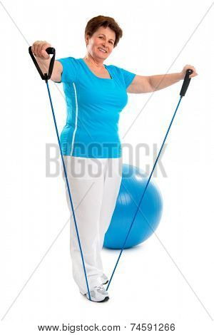 senior woman doing exercises with a resistance band
