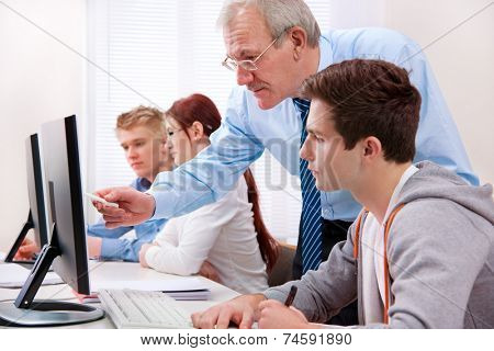 Students with a teacher in computer classroom