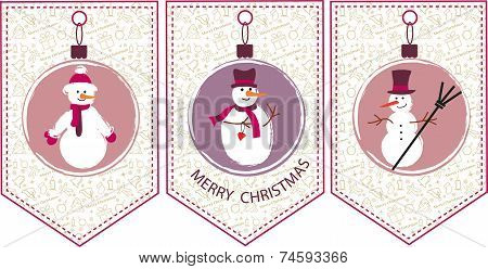 three decoration  Christmas balls with snowmen. seasonal card
