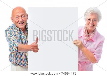 happy smiling senior couple holding a blank board isolated on white