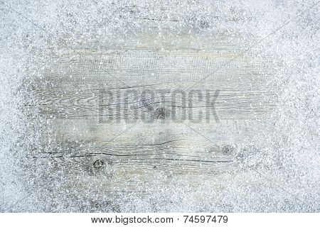 Old wooden board with snow flakes . Christmas background