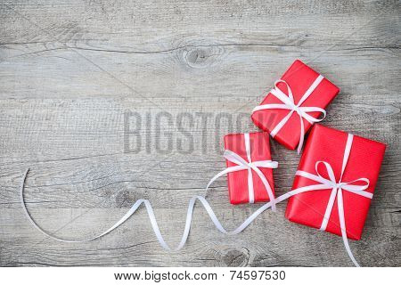 Gift boxes with bow on wooden background