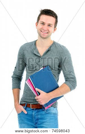 Smiling teenager with schoolbooks and hand in pocket standing on white background