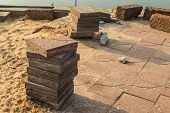 stock photo of interlock  - Stacks of interlocking stones for installing driveway landscaping - JPG