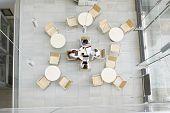 stock photo of canteen  - High angle view of businesswomen working in office canteen - JPG