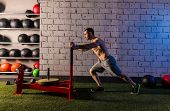 image of sled  - sled push man pushing weights workout exercise - JPG