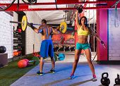 foto of kettlebell  - Barbell weight lifting man and woman rising kettlebell gym weightlifting - JPG