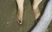 stock photo of suny  - Two legs in sea waves - JPG