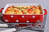 stock photo of crust  - Vegetables with cheese crust in a ceramic baking dish - JPG
