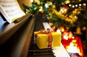stock photo of christmas song  - Christmas gift on piano - JPG