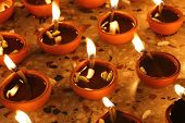 pic of diwali lamp  - traditional oil lamps in a row - JPG