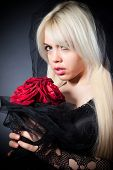 pic of grief  - black widow in grief with flowers with a veil on a black background - JPG