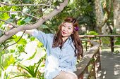 foto of filipina  - Pinoy woman in a green garden on farm - JPG