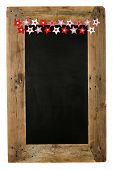 stock photo of wooden pallet  - Chalkboard christmas restaurant menu board reclaimed pallet wooden frame and small red gingham polka dots striped pillow stars with buttons isolated on white with copy space - JPG