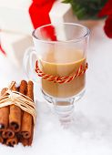 foto of blanket snow  - Christmas still life with a Christmas decorations presents and hot chocolate nestling in fresh snow - JPG